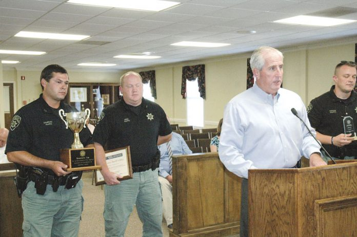 Coweta County Sheriff Mike Yeager (white shirt, at podium) in 2017. File photo.