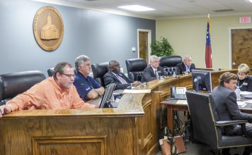 The Coweta County Commission. Pictured, from left, are commissioners Rodney Brooks and Tim Lassetter, Chairman Al Smith, and commissioners Paul Poole and Bob Blackburn. Photo/Ben Nelms.
