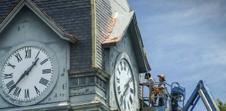 Technicians work on the clock tower of the historic former Fayette County Courthouse on the Square in Fayetteville in this file photo from 2015.