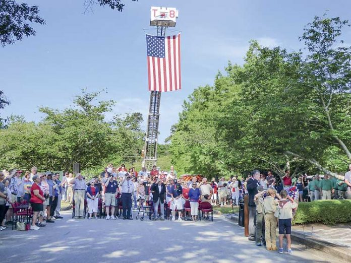 Last year's Peachtree City Memorial Day observance featured a big crowd and a big flag. File photo.