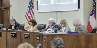 The Peachtree City Council on Dec. 7 approved a bid for intersection work at MacDuff Parkway and Ga. Highway 54 West. Pictured, from left, are Councilman Mike King, Mayor Vanessa Fleisch and council members Terry Ernst, Kim Learnard and Phil Prebor. Photo/Ben Nelms.