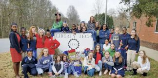 "Posing in front of the school sign a year ago are some of the numerous students at Liberty Tech Charter School in Brooks who formed an ""Ambassadors 4 Kids"" club to prevent bullying. Photo/Submitted."