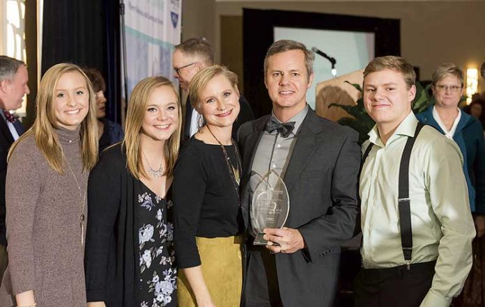 Above, holding the award for 2018 Outstanding Business Person of the Year from the Fayette County Chamber of Commerce is (center) Joe Domaleski, flanked by (L-R) daughters Tori and Alex, wife Mary Catherine and son Stephen. Photo/Roger Sibaja, Gobi Photography.