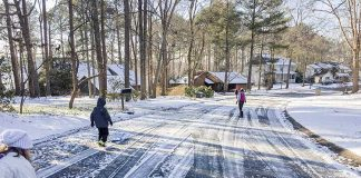 A Peachtree City resident shared this picture of a neighborhood near Lake Peachtree and how some of the neighbors were making use of an uncommon mid-week day off because of snowfall. Photo/Jennifer Vetter.