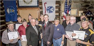 "GDVS Commissioner Mike Roby (center, left) and state Sen. Marty Harbin (center, right) presented members of American Legion Post 105 with their Vietnam War Certificates of Honor. The Legionnaires received their certificates at a ceremony held at the ""Log Cabin"" in Fayetteville in February 2016. Photo/Submitted."