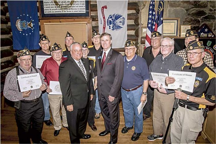 """GDVS Commissioner Mike Roby (center, left) and state Sen. Marty Harbin (center, right) presented members of American Legion Post 105 with their Vietnam War Certificates of Honor. The Legionnaires received their certificates at a ceremony held at the """"Log Cabin"""" in Fayetteville in February 2016. Photo/Submitted."""