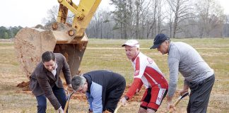 March 16 groundbreaking activities for the Piedmont Wellness Center at Pinewood Forest in Fayetteville included, from left, Pace Lynch Realty co-founder Jason Pace, Piedmont Fayette Hospital CEO Michael Burnett, Pinewood Forest Chief Visionary Dan Cathy and Pinewood Forest President Rob Parker. Photo/Ben Nelms.