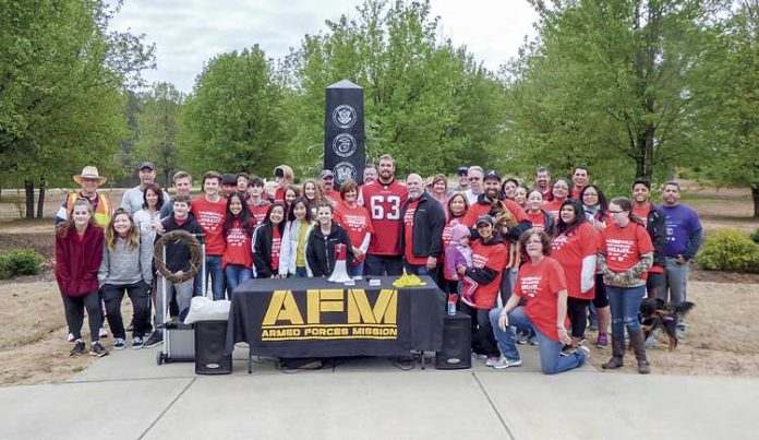 A large group attended the March 24 inaugural LOSS (Local Outreach to Suicide Survivors) Walk at Patriot Park in Fayetteville. Wearing the No. 63 jersey was Atlanta Falcons guard and veteran Ben Garland. Photo/Ben Nelms.