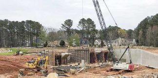 Work on the spillway on Lake Peachtree continues, with substantial completion expected by mid-June. Photo/Ben Nelms.