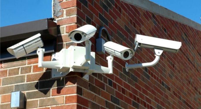 Stock photo of array of school surveillance cameras.
