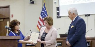 Drug Free Fayette representative Jean Felts (C) on April 5 received a proclamation by Peachtree City Mayor Vanessa Fleisch (L) and Councilman Phil Prebor signifying April as Alcohol Awareness Month in Fayette County. Photo/Ben Nelms.