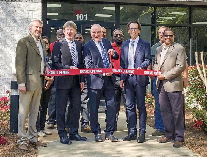 SILON representatives were joined by govenment and industry guests at the April 12 ribbon-cutting at the company's $20 million industrial plant in Peachtree City. Pictured, from left, are SILON Plant Manager Scott Whiteside, CFO Dr. Bernd Morawitz, CEO Dr. Wolfgang Riediger, COO Drahomir Koudelka and Technical Services and QA Manager Carl Mahabir. Photo/Submitted.