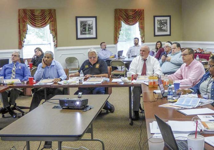 Fayette County Commission members attending the 2018 retreat on April 18-20 included, from left in the foreground, commissioners Chuck Oddo, Charles Rousseau and Randy Ognio, Chairman Eric Maxwell and Commissioner Steve Brown. Photo/Ben Nelms.