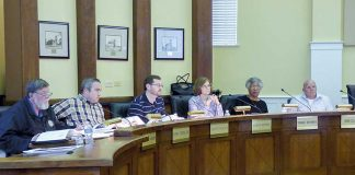 Members of the Fayetteville Planning and Zoning Commission include, from left, commissioners Ken Collins, Toby Spencer, Brett Nolan, Chairman Sarah Murphy and commissioners Debi Renfroe and Joe Clark. Photo/Ben Nelms.