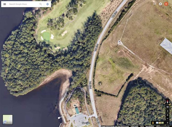 A 5.1-acre undeveloped peninsula, at left, adjacent to the Planterra golf course in Peachtree City and surrounded on three sides by Lake McIntosh is proposed for lakefront condominium development. Graphic/Google Maps.