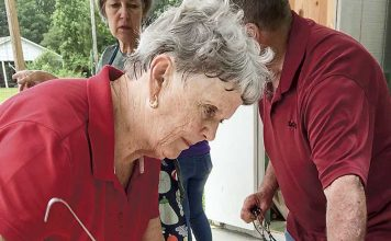 Hopewell UMC member, Beth James, carefully fills jars with freshly made strawberry jam. The strawberries come from the Tyrone church's garden and members and neighbors pitch in to can the harvest. Photo/Sandy Golden.