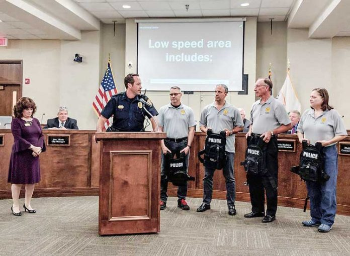 The Peachtree City Auxiliary Police Force recently presented officers with active shooter vests. Pictured, from left, at the presentation were Mayor Vanessa Fleisch, Lt. Brad Williams, auxiliary Capt. John McDonald, auxiliary officers Joe Radest and Fred Dunkelberger and auxiliary Lt. Arline Cuebas. Photo/Submitted.
