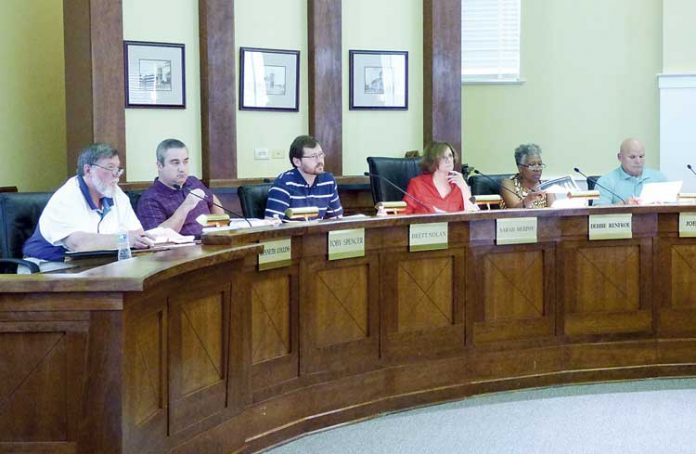 Members of the Fayetteville Planning and Zoning Commission include, from left, commissioners Ken Collins, Toby Spencer, Brett Nolan, Chairman Sarah Murphy and commissioners Debi Renfro and Joe Clark. Photo/Ben Nelms.