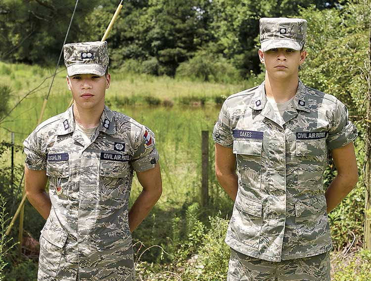 Civil Air Patrol Cadets 1st Lt. Davis Laughlin and 2nd Lt. Justin Oakes on the scene of accident; pond is behind them. Photo/Diane Gentzke.