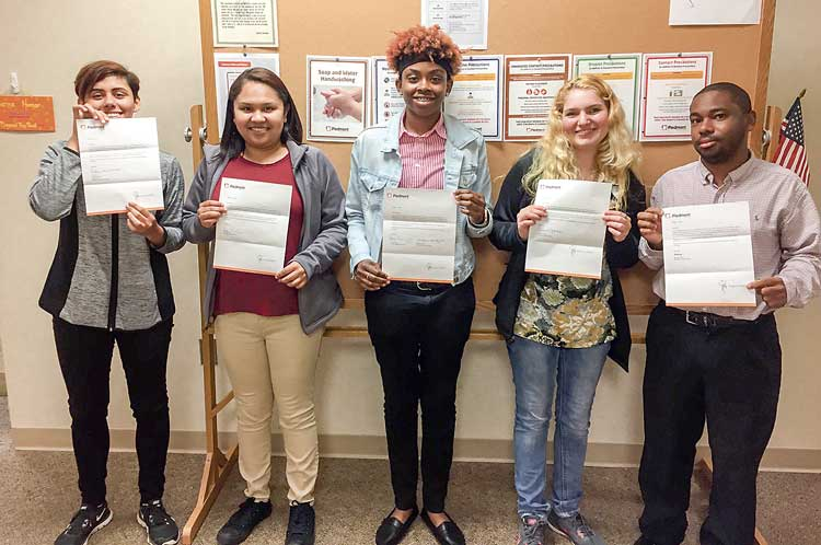 The students with their acceptance letters are (L-R) Eden, Jazmin, Chanelle, Danielle and Josh. The acceptance letters are from the departments they will be working in at Piedmont Fayette. Photo/Piedmont Fayette Hospital.