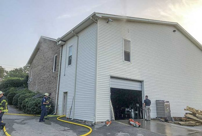 Firefighters clean up following an Aug. 24 fire at Fayette Floor and Wallcovering in Fayetteville . Photo/Fayetteville Fire Department.