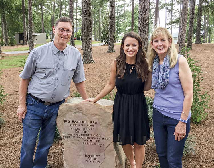 Jim and Mary Pace, along with Rachel Cathy (C) were at Berry College in Rome on Aug. 18 for the unveiling of the Pace Adventure Course, named for their daughter, Kim, who worked with WinShape Teams on the Berry campus. Photo/Submitted.