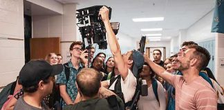 """High school students dualenrolled in the school system's new film course learn firsthand from the """"BeastBeast""""crew about film productiontechniques. The students were on setduring recent filming at Rising StarrMiddle School. Photo/Submitted."""
