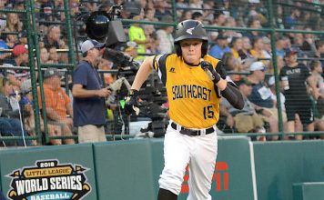 Peachtree City's Connor Riggs-Soper runs home after reaching base with a double during the second inning of a Little League World Series game against the Mid-Atlantic. Photo/Brett R. Crossley.