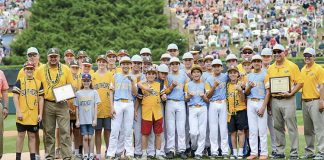 Competitors become friends — It's a mixture of the world's best Sunday, as members and coaches of the Peachtree City American Little League team (in yellow jersies) mingle with the World Series winner Hawaii after both teams received an unprecedented honor: A joint sportsmanship award. Photo/Brett R. Crossley.