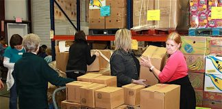 Volunteers work in the warehouse at Midwest Food Bank in Peachtree City. Photo/Midwest Food Bank.