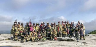 Public safety personnel from Fayetteville, joined by those from other agencies, scaled Stone Mountain on Sept. 11 to honor the memories of first responders who lost their lives at the World Trade Center on Sept. 11, 2001. Photo/Stone Mountain Park.