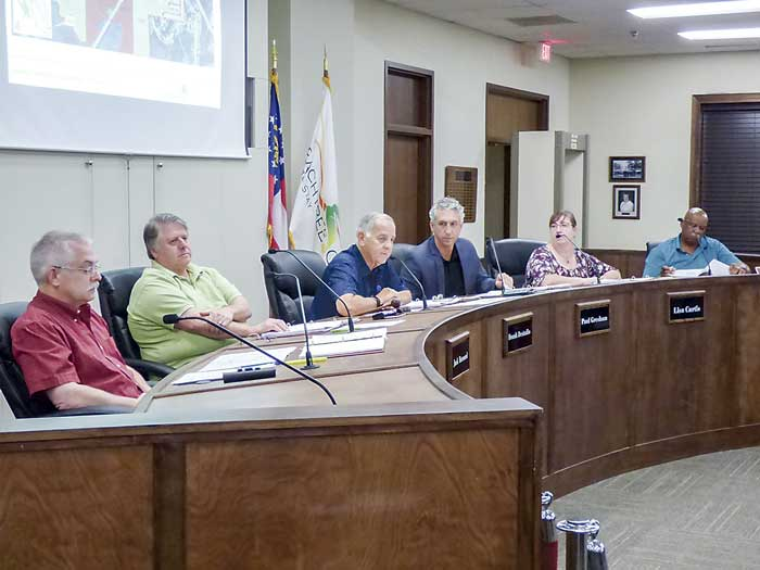Members of the Peachtree City Planning Commission at the Sept. 24 meeting included, from left, commissioners J.T. Rabun and Jack Bernard, Chairman Frank Destadio, and commissioners Paul Gresham, Lisa Ann Curtis and alternate Commissioner Michael Link. Photo/Ben Nelms.