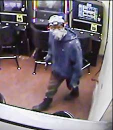 Surveillance photo of a sledgehammer burglar. Photo/Fayetteville Police Dept.