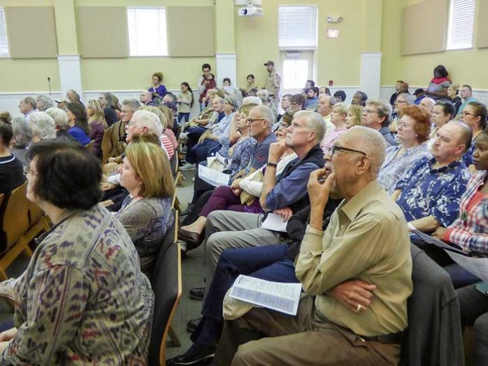Part of the crowd hearing the rezoning proposal. Photo/Ben Nelms.