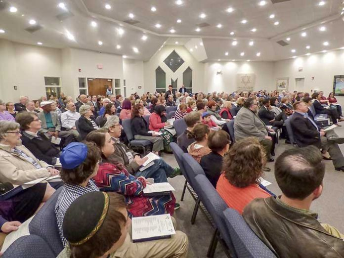 The large sanctuary at the Congregation B'nai Israel east of Fayetteville was filled Nov. 2 with those of all faiths who attended a service of solidarity for the victims of the Pittsburgh synagogue shootings. Photo/Ben Nelms.