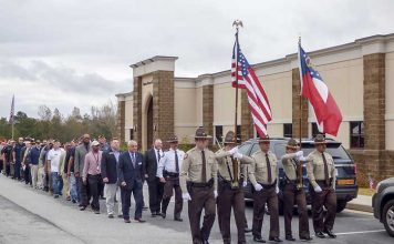 Fayette County law enforcement and first responders march with veterans at a commemorative ceremony for Veterans Day at Georgia Military College in Fayetteville. Photo/Ben Nelms.