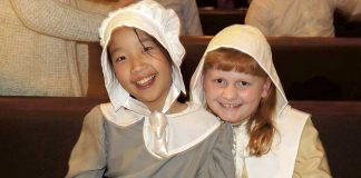 "Crossroads Christian School fifth-grade students Hannah Cooke and Katie Ferrell take a moment after their school's Thanksgiving play Nov. 15. Every student performed in ""The First Thanksgiving,"" which commemorates the Pilgrims' quest for religious freedom, God's provision, and the friendship of Native Americans to the newcomers. Photo/Submitted."