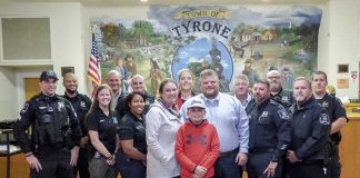 Former Tyrone Police Chief and new Town Manager Brandon Perkins (center) was joined by wife, Amy, and son, Cooper, at the Nov. 15 meeting of the Town Town Council. They are accompanied by members of the Tyrone Police Department. Photo/Ben Nelms.