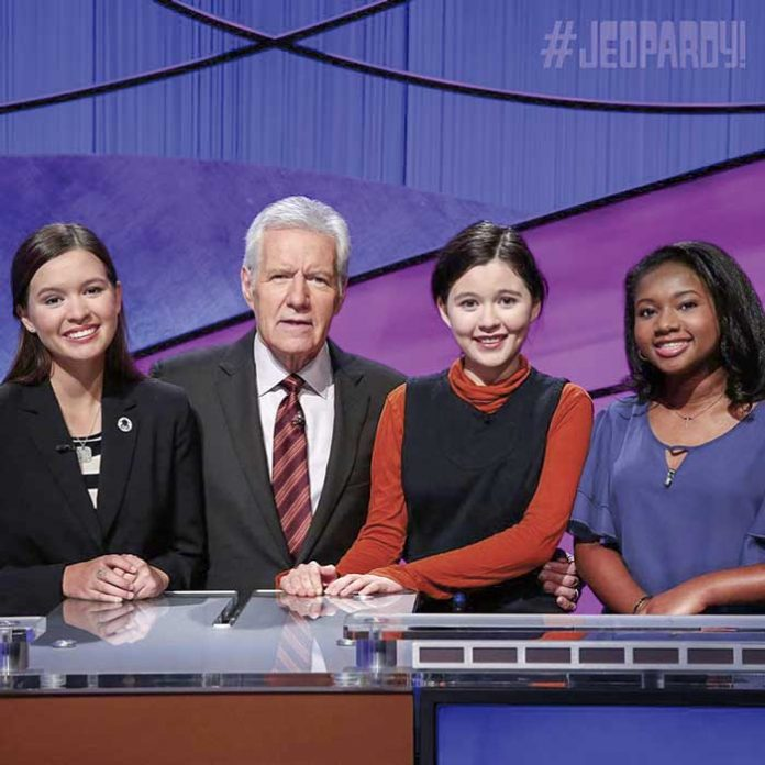 "Maya Wright, far right, with her two opponents in the finals of the ""Jeopardy!"" Teen Tournament along with host Alex Trebek. Photo/Jeopardy.com."