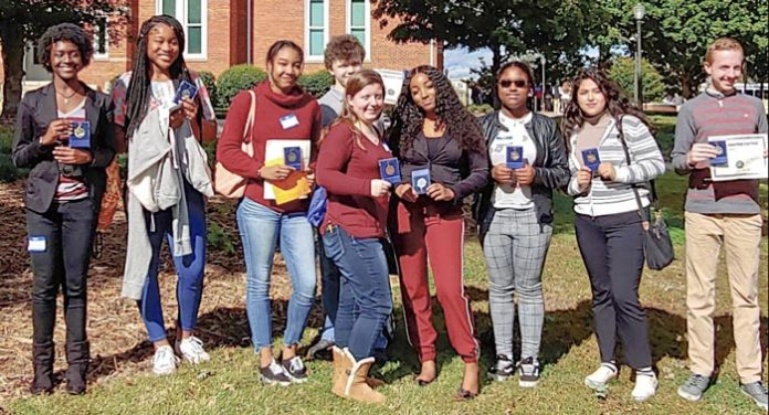 Foreign language students at Sandy Creek High display award medals from poetry contest. (L-R): Lydia Jenkins, Madalya Hardnett, Andrea Huisso, Will Lockridge, Anna Pate, Aiyanna Gulley, Stacy Gonzalez, and Jonathan McClenny. Photo/Submitted.