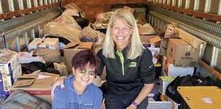 Kathy Gloer and friend Sandi Donaldson help to load a trailer full of relief supplies for hurricane victims in the Florida panhandle. Photo/Hearts with Hope Facebook page.