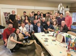 Family, friends and local veterans on Dec. 1 honored World War II veteran Salvatore Bordonaro (front, center) at his 100th birthday party. Photo/Ben Nelms.