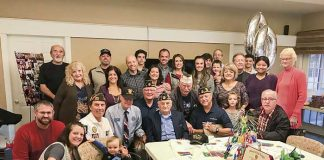 Family, friends and local veterans on Dec. 1 honored World War II veteran Salvatore Bordonaro (front, center) at his 100th birthday party. Photo/Ben Nelms.