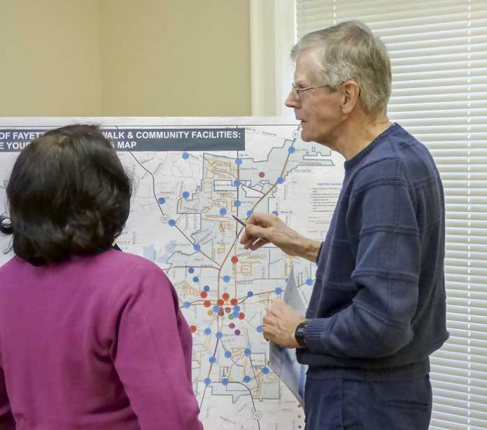 Fayetteville City Planner LaShawn Gardiner (left) discusses city planning activities with Richard Sprague at a Nov. 28 meeting at Fayette Senior Services. Photo/Ben Nelms.