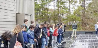 McIntosh High School 9th grade STEM (Science, Technology, Engineering and Math) students got a close-up look at massive solar array recently installed at the Crown Plaza Atlanta SW hotel on Aberdeen Parkway in Peachtree City. Photo/Ben Nelms.