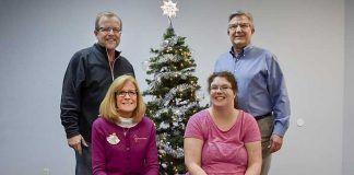 Helping to bring cheer to families with children having special needs are (front L-R) Jenny Bellamy and Chelsey Johnson; (back) Scott Johnson and Jim McCarten. Photo/Submitted.