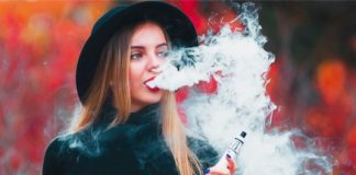 Shutterstock image of woman holding a vaping device.