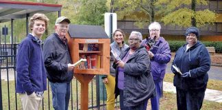 Cooper Roman, an Eagle Scout and Peachtree City resident, recently built and installed four Little Free Libraries on the campus of Christian City. Cooper is pictured with several active senior residents and staff at the library located next to the Dog Park. From left are Cooper Roman, Danny O'Neal, Tyler Wright, Director of Campus Recreation, Arlene White, Gloria Kerns (with her dog Zippy), and Renee Trice. Photo/Larry Regier.