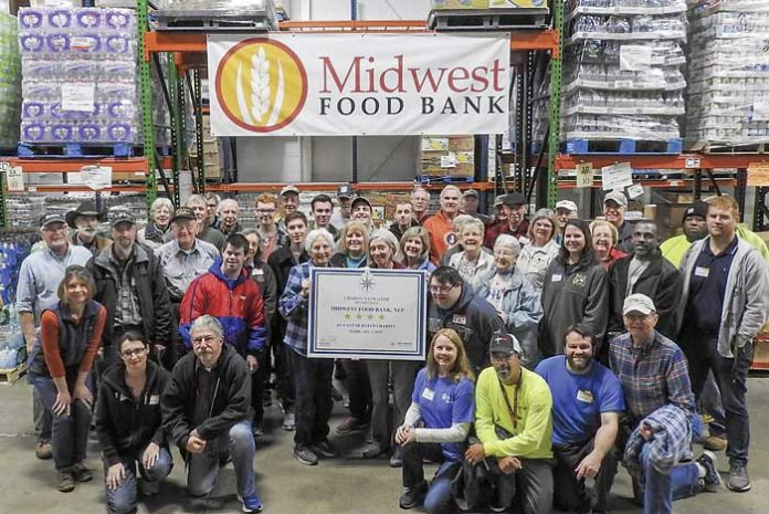 Employees and volunteers celebrate the award at the facility in Peachtree City. Photo/Submitted.