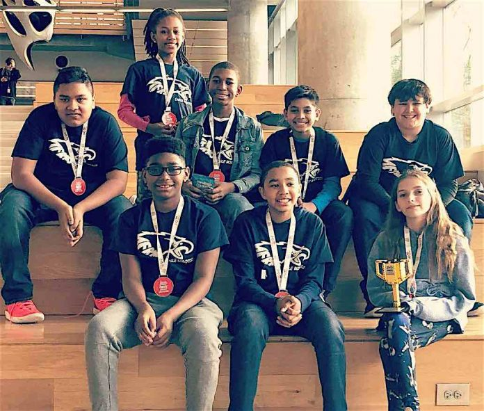 Team I.C.E. shows off their medals and trophy awarded to them for winning the research award at the Georgia First Lego League State Championship held at Georgia Tech. (L-R) Back Row: Michael Baksh, Bre'Yon Guidry, Tyson White, Darion Nandial, Jaden Torres; Front Row: Nicholas Jenkins, Dylan Felker, and Madison Lohr. Photo/Fayette County School System.